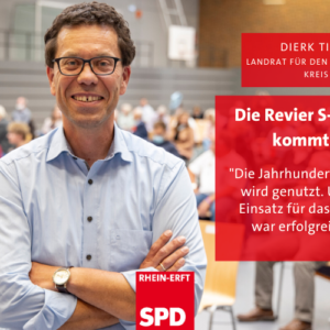 """Dierk Timm, lächelnd mit verschränkten Armen: """"Die Revier-S-Bahn kommt! Das ist unser ERfolg!"""""""